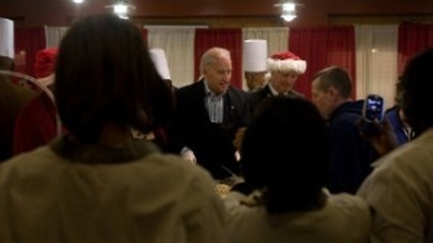 Vice President Joe Biden serves lunch to patients and staff in the dining facility at Walter Reed Army Medical Center on Christmas Day, December 25, 2009. The Vice President and Dr. Biden served Christmas lunch and met with families and wounded soldiers during their visit to Walter Reed.  (Official White House Photo by David Lienemann)