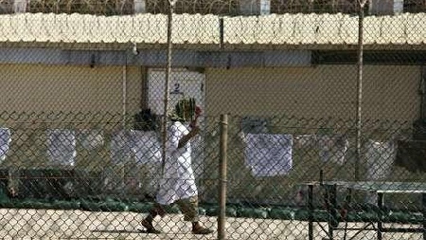 In this May file photo, a detainee walks inside the open-air yard at Camp 4 detention facility at Guantanamo Bay U.S. Naval Base, Cuba. (Reuters Photo)