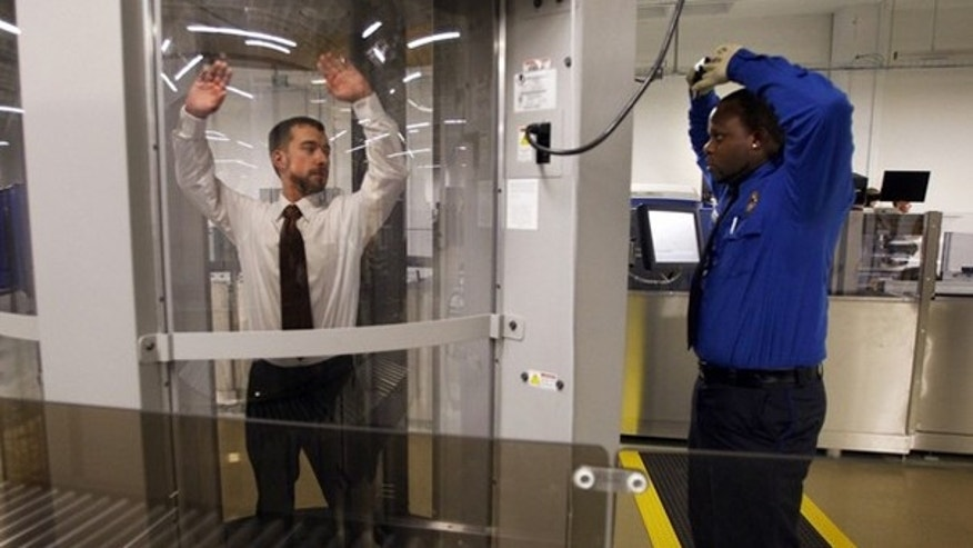 FILE: Undated: Transportation Security Administration staffers at the agency's Washington, D.C., training facility demonstrate a full-body scanning machine.