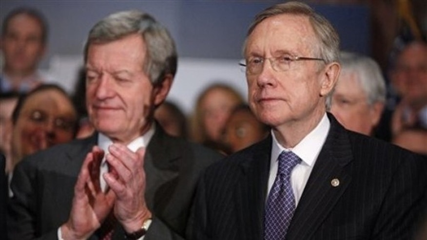 Senate Majority Leader Harry Reid, right, attends a news conference on Capitol Hill Dec. 22, along with Senate Finance Committee Chairman Max Baucus. (AP Photo)