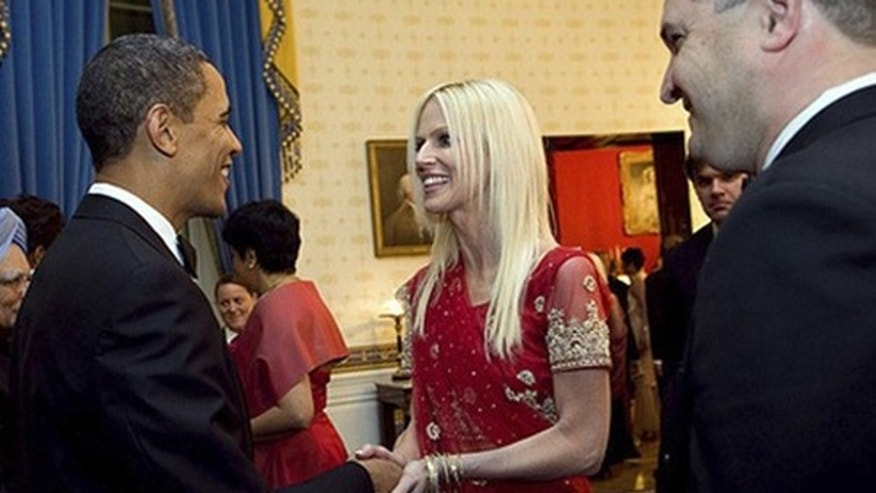 President Obama greets Michaele Salahi and her husband Tareq during a state dinner Nov. 24. (Reuters/White House)