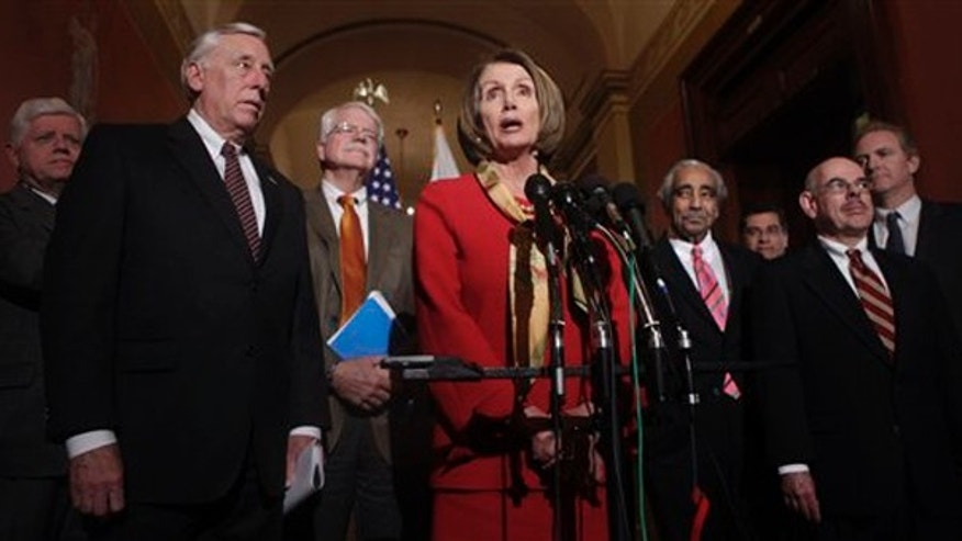 House Speaker Nancy Pelosi, center, speaks during a health care news conference on Capitol Hill Jan. 5. (AP Photo)