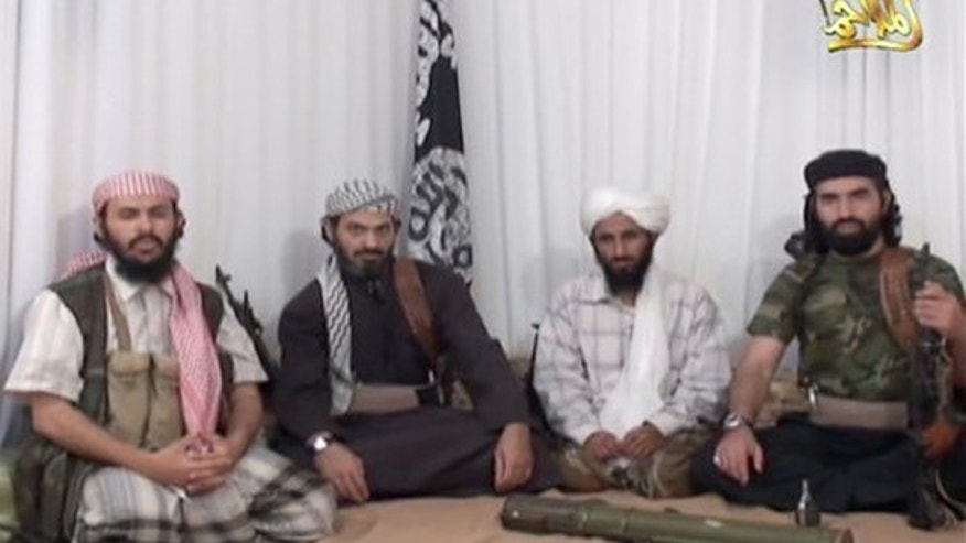 Dec. 30, 2009: This photo taken from a video released Jan. 23, 2009 by al-Malahim Media Foundation, the media arm of Al Qaeda in the Arabian Peninsula. Two of the men Said al-Shihri, second from left, and Abu al-Hareth Muhammad al-Oufi, far right, were both housed at Guantanamo Bay but released. Al-Oufi surrendered in Yemen recently and was handed over to Saudis (AP/IntelCenter)