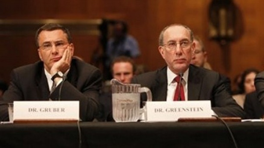 May 12, 2014: MIT professor Jonathan Gruber, left, and Robert Greenstein, executive director of the Center on Budget and Policy Priorities, right, testify on Capitol Hill about health care reform.