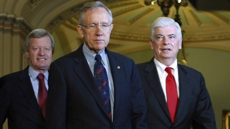 Dec. 24: Senate Majority Leader Harry Reid walks with Sens. Christopher Dodd and Max Baucus after the Senate approved President Obama's health care bill on Capitol Hill. (Reuters)