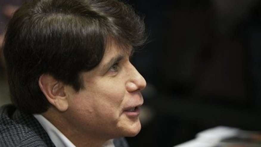 Former Illinois Gov. Rod Blagojevich talks to customers at a book signing in Chicago Dec. 8. (AP Photo)