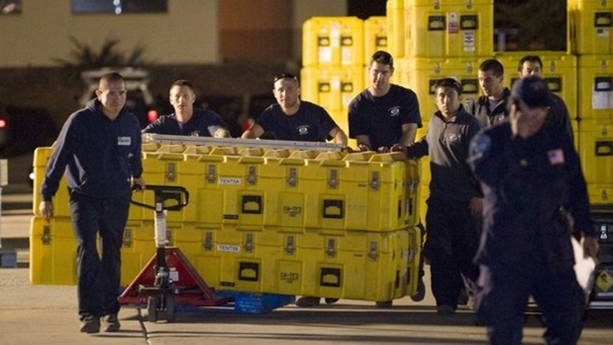 The Los Angeles County Fire Department urban search and rescue team loads equipment before heading to Haiti Jan. 12. (Reuters Photo)