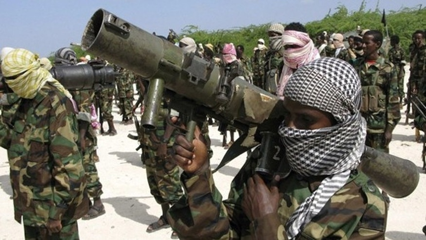 A handout released to Reuters by IntelCenter shows members of Somalia's Islamist rebel group al Shabaab in Mogadishu Jan. 1. (Reuters Photo)