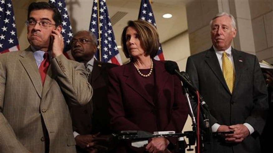 From left to right, Rep. Xaiver Becerra, D-Calif., Majority Whip James Clyburn, D-S.C., House Speaker Nancy Pelosi, D-Calif., and House Majority Leader Steny Hoyer, D-MD., speak to reporters Jan. 14 in Washington. (AP Photo)