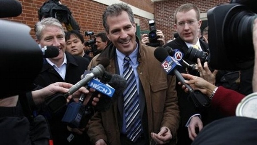 Republican Scott Brown speaks to reporters after voting in the special election Jan. 19 in Wrentham, Mass. (AP Photo)