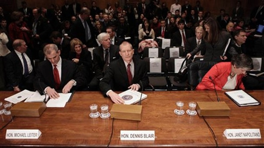 From left, National Counterterrorism Center Directir Michael Leiter, Director of National Intelligence Dennis Blair, and Homeland Security Secretary Janet Napolitano take their seats before testifying on Capitol Hill Jan. 20. (AP Photo)