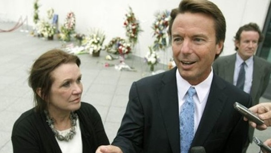 Former Sen. John Edwards arrives with his wife Elizabeth for the late Sen. Edward Kennedy's memorial service in Boston Aug. 28, 2009. (AP Photo)