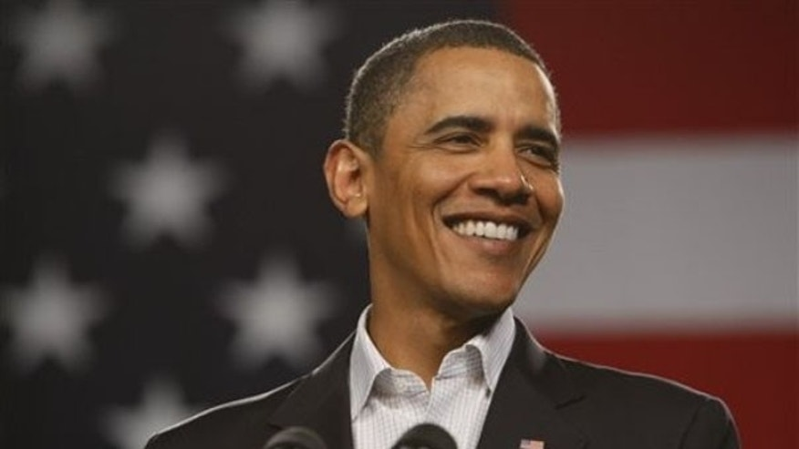 Friday: President Obama smiles at a town hall meeting at Lorain County Community College in Elyria, Ohio. (AP Photo)