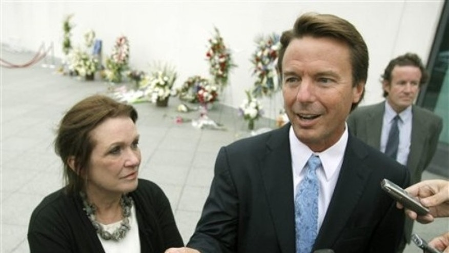 Aug. 28, 2009: Former Sen. John Edwards, right, arrives with his wife Elizabeth, for the late Sen. Edward Kennedy's memorial service at the John F. Kennedy Library and Museum in Boston (AP).