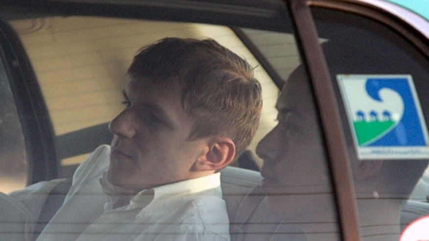 Jan. 26:  James O'Keefe and Stan Dai leave the St. Bernard Parish jail a taxi cab in Chalmette, La. O'Keefe, a conservative activist who posed as a pimp to target the community-organizing group ACORN, is one of four people arrested by the FBI and accused of trying to interfere with phones at Sen. Mary Landrieu's office in New Orleans. (AP)