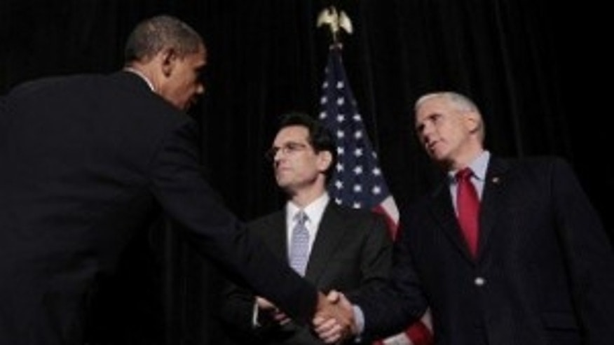 President Obama shakes hands with Rep. Mike Pence (R-IN), as House Minority Whip Eric Cantor (VA) looks on at the GOP House Issues Conference in Baltimore. (AP Photo)