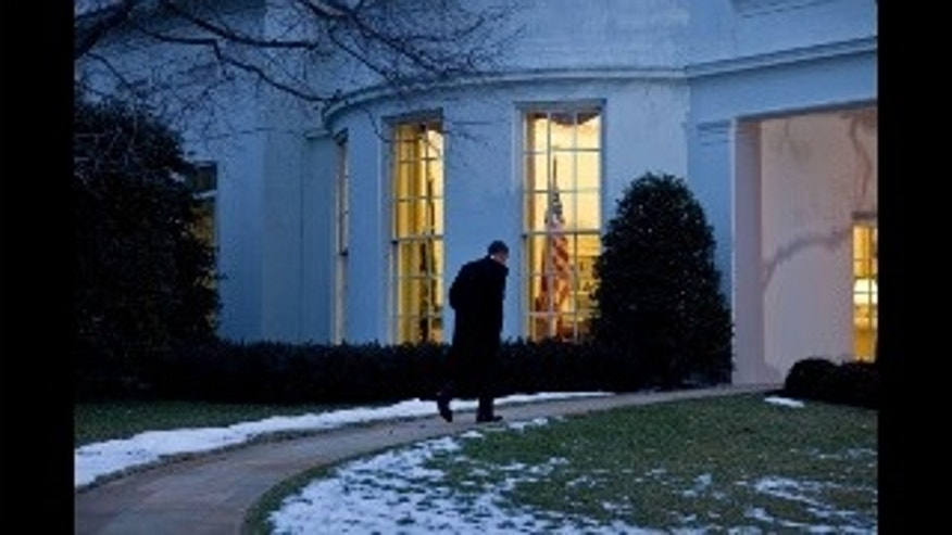 President Barack Obama walks to the Oval Office after returning to the White House following a trip to Nashua, N.H., Feb. 2, 2010. (Official White House Photo by Chuck Kennedy)