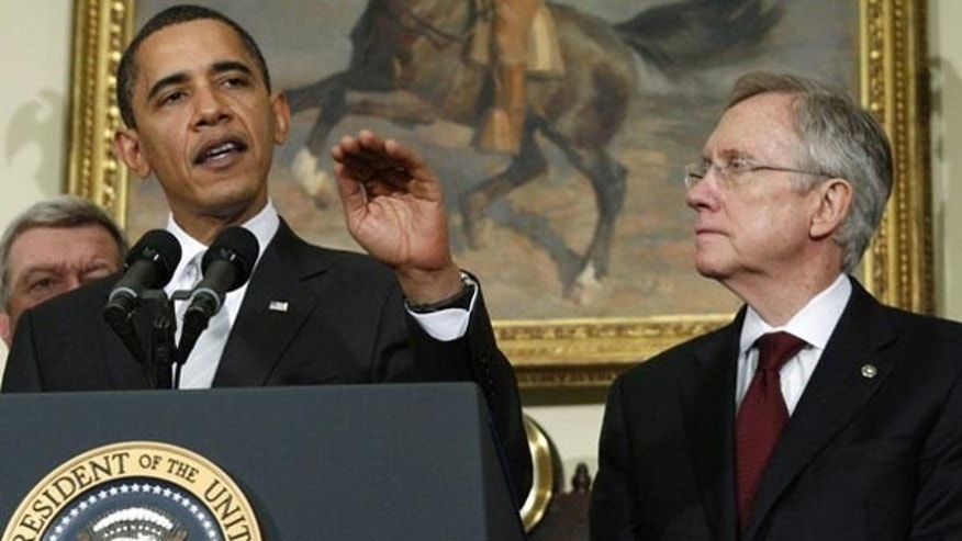 In this December 15, 2009 file photo, President Obama makes remarks on his meeting with Democratic senators about health care legislation as Senate Majority leader Harry Reid listens in the Roosevelt Room at the White House. (Reuters)