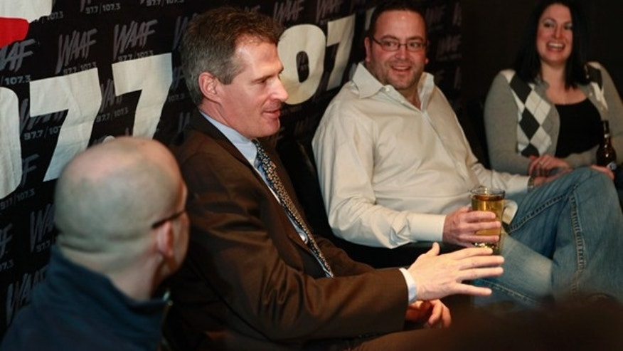 "Tuesday: Sen.-elect Scott Brown sits with Boston radio personality Greg Hill, second from right, during a so-called ""beer summit"" at a bar in Boston's South End neighborhood to benefit the charity Homes for Our Troops. (AP Photo)"