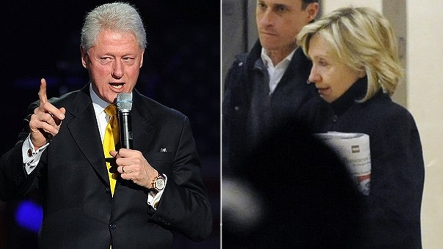 Secretary of State Hillary Clinton, right, is seen leaving the New York hospital where her husband, former President Bill Clinton, is recovering. Last week he spoke at the 'Help for Haiti' benefit concert in Miami.