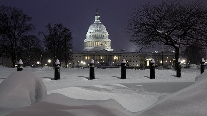 Feb. 10: The U.S. Capitol is seen at twilight at the end of a record snowfall.