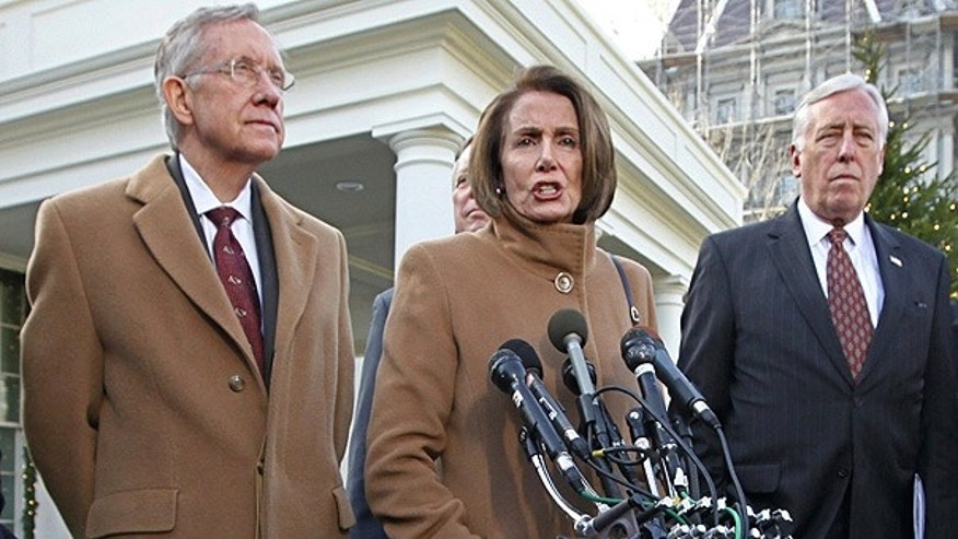Dec. 9: House Speaker Nancy Pelosi is flanked by Senate Majority Leader Harry Reid, left, and House Majority Leader Steny Hoyer, outside the White House.