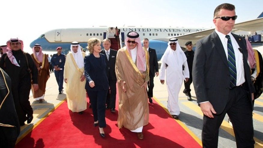Monday: Secretary of State Hillary Clinton walks with Saudi foreign minister Prince Saud Al-Faisal upon her arrival at King Khalid International Airport in Riyadh, Saudi Arabia. (AP)