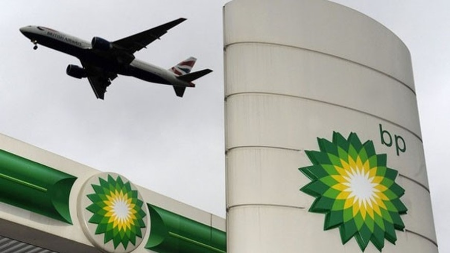 A plane flies over a British Petroleum gas station at Heathrow in London Feb. 2. (Reuters Photo)