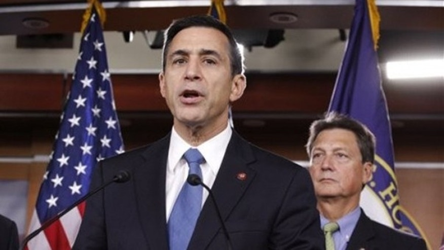 File: Sept. 17, 2009: Rep. Darrell, Issa, R-Calif., accompanied by Rep. Lynn Westmoreland, R-Ga. , discusses a House bill.