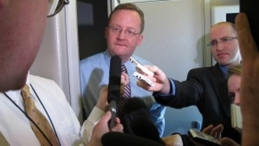 White House Press Secretary Robert Gibbs briefs reports on Air Force One