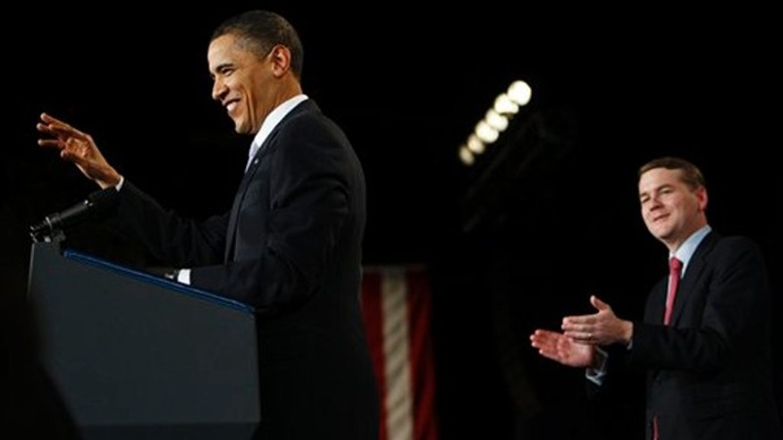 President Obama, left, and Sen. Michael Bennet, D-Colo., right, speaks during a fundraiser for Bennet at the Filmore Auditorium in Denver, Thursday, Feb. 18, 2010. (AP)