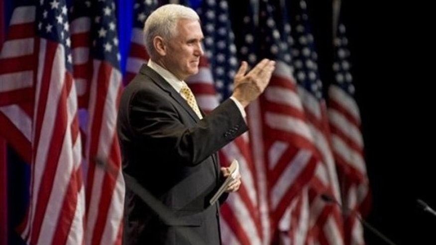 In this Feb. 19, 2010, file photo Rep. Mike Pence, R-Ind., gestures while addressing the Conservative Political Action Conference (CPAC) in Washington.