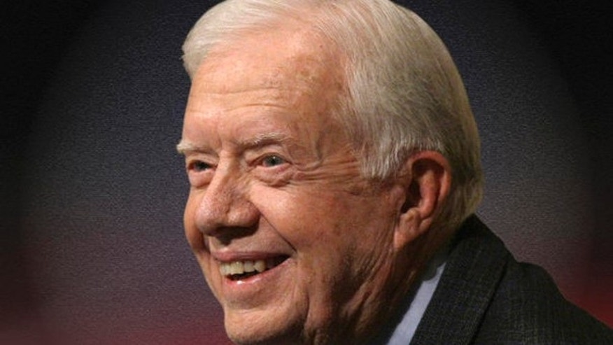 Former President Jimmy Carter supports a humanitarian group's claim that its free speech rights are violated by an antiterror law that prohibits material support for 'foreign terrorist organizations' (AP Photo).