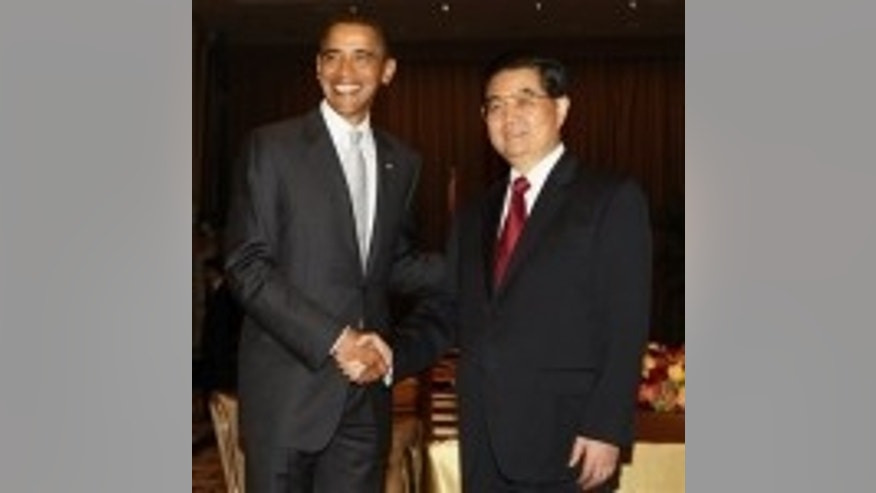 President Barack Obama meets with China's President Hu Jintao in New York, Tuesday, Sept. 22, 2009. (AP Photo/Charles Dharapak)