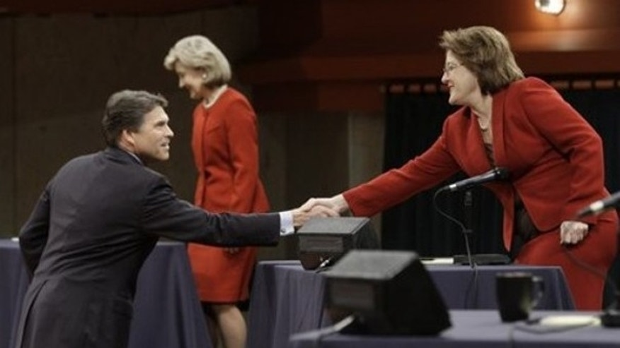 Jan. 14: Republican candidates for Texas Governor Debra Medina, right, shakes hands with Texas Gov. Rick Perry, left, as U.S. Sen. Kay Bailey Hutchison sits down before the Texas GOP gubernatorial debate at the Murchison Performing Arts Center at the University of North Texas in Denton, Texas. (AP Photo/Pool,LM Otero)