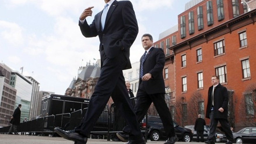 Feb. 25, 2010: President Obama walks away from the Blair House during a lunchbreak at a health care summit with bipartisan leaders from Capitol Hill in Washington.