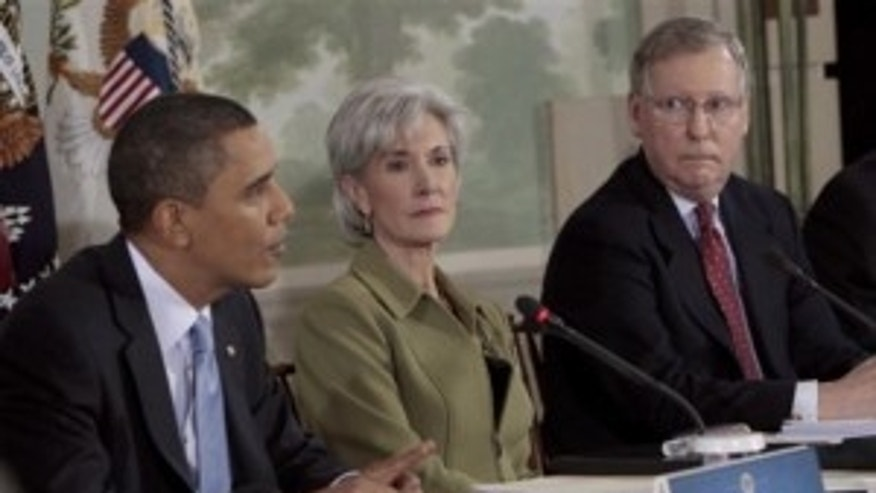 Senate Minority Leader Mitch McConnell (KY), right, and Health and Human Services Secretary Kathleen Sebelius, center, listens to President Obama during a health care reform meeting at the Blair House. (AP Photo)