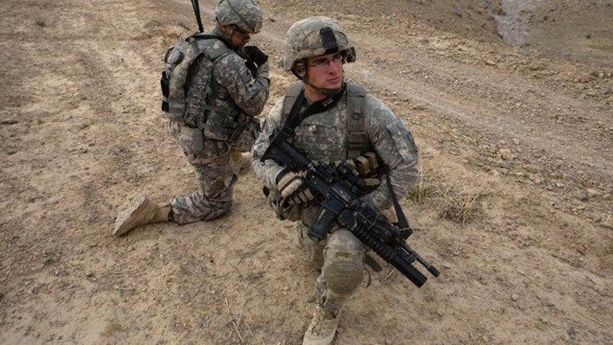 Feb. 26, 2010: U.S. Army soldiers from Delta Company 4th Brigade combat team, 2-508, 82nd parachute infantry regiment, kneel during a patrol in the Arghandab valley in Kandahar province, southern Afghanistan.