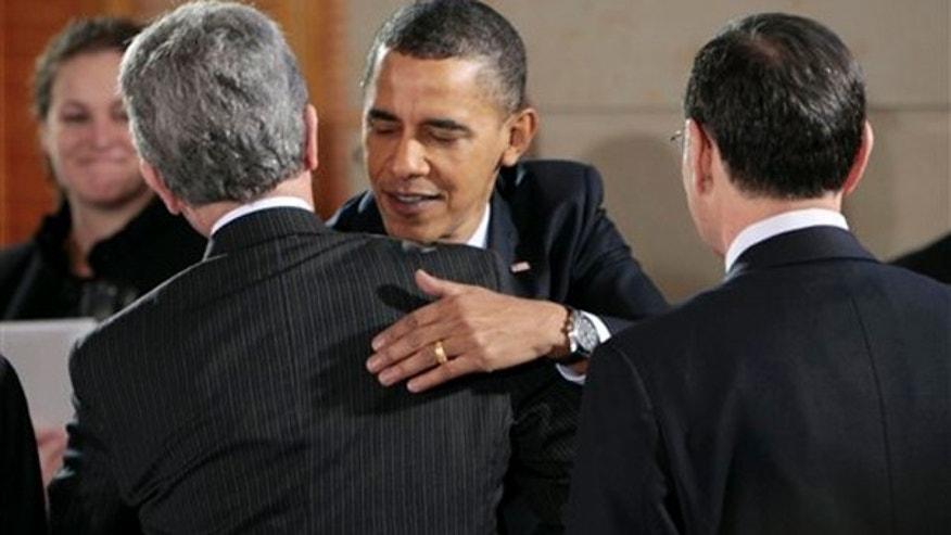 President Obama greets Sen. Tom Coburn, R-Okla., as Sen. John Barrasso, R-Wyo., looks on at right, Thursday, Feb. 25, 2010, in the Blair House across the street from the White House in Washington. (AP)