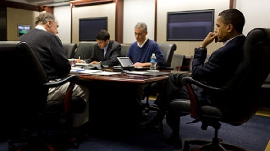 President Barack Obama holds conference call from the Situation Room of the White House concerning the earthquake in Chile, Feb. 27, 2010. Pictured are, left to right, Tom Donilon, deputy national security advisor, Rajiv Shah, administrator of USAID, and Rahm Emanuel, White House chief of staff. Other Cabinet officials joined the meeting by phone. (White House)