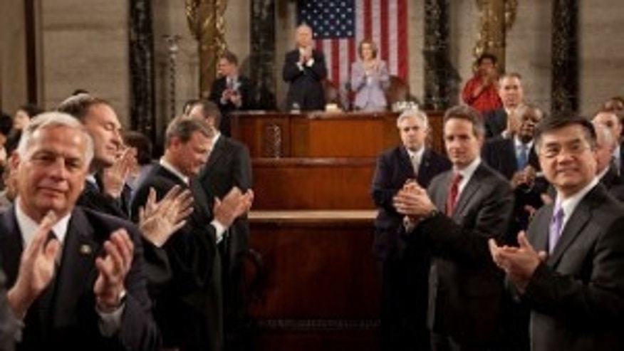 Vice President Biden, Speaker Pelosi and other members of Congress, the Cabinet, and Supreme Court applaud as President Obama enters the House Chamber to deliver his State of the Union address on Jan. 27, 2010 (WH Photo)