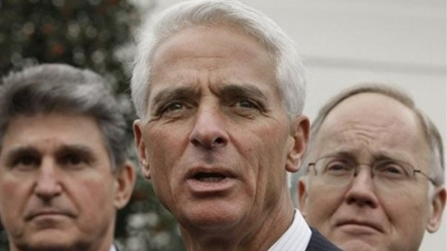 Florida Gov. Charlie Crist, center, flanked by National Governors Association (NGA) Vice Chairman, West Virginia Gov. Joe manchin, left, and NGA Chairman, Vermont Gov. Jim Douglas, speaks with reporters outside the White House in Washington, Monday, Feb. 22, 2010, after the NGA met with President Obama. (AP)