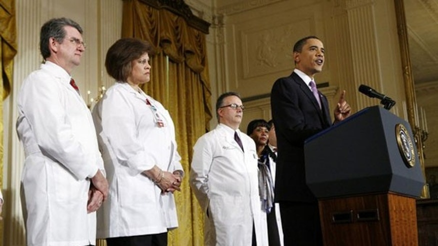 President Obama speaks about health care reform, as medical professionals look on, at the White House in Washington March 3. (Reuters Photo)