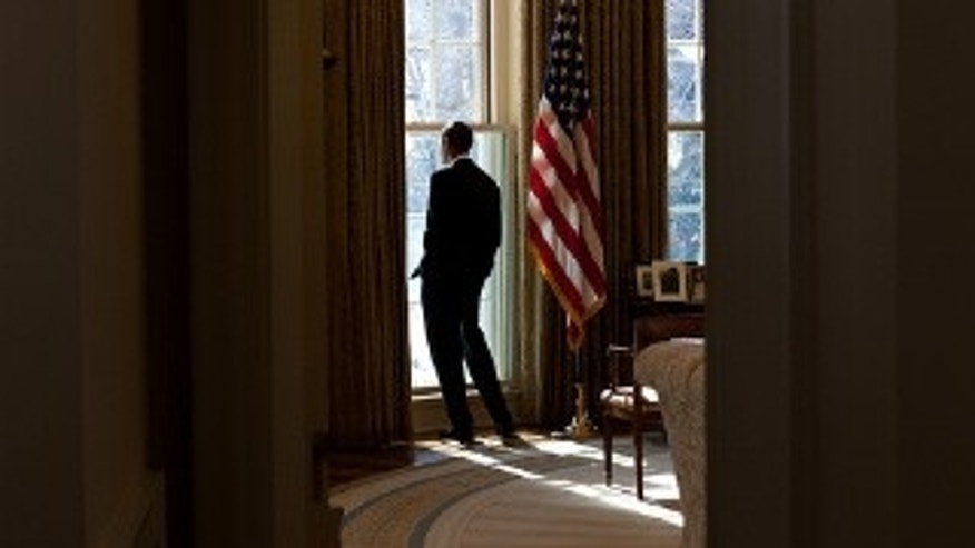 President Barack Obama looks out the window of the Oval Office, Feb. 12, 2010. (Official White House Photo by Pete Souza)