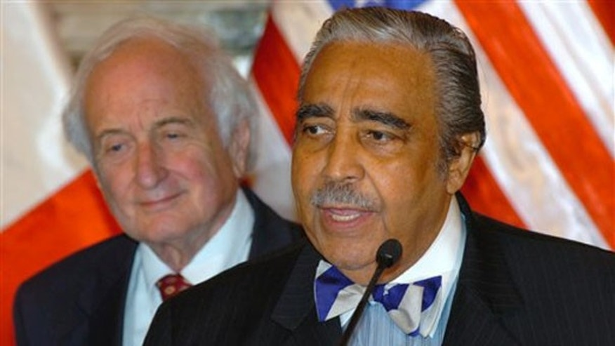 In this Aug. 6, 2007, file photo, Rep. Sander Levin, left, listens to Rep. Charles Rangel in Lima, Peru. (AP Photo)