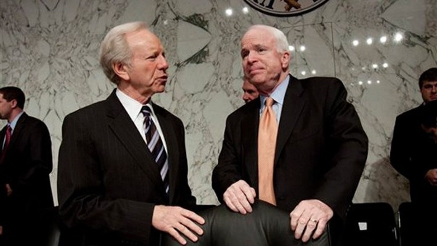 The Senate Armed Services Committee's ranking Republican Sen. John McCain, R-Ariz., right, talks with committee member Sen. Joseph Lieberman, I-Conn. on Capitol Hill in Washington, Thursday, March 4, 2010. (AP)