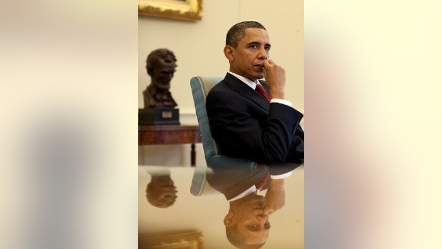 President Barack Obama listens during a meeting with senior advisors in the Oval Office, Jan. 25, 2010.