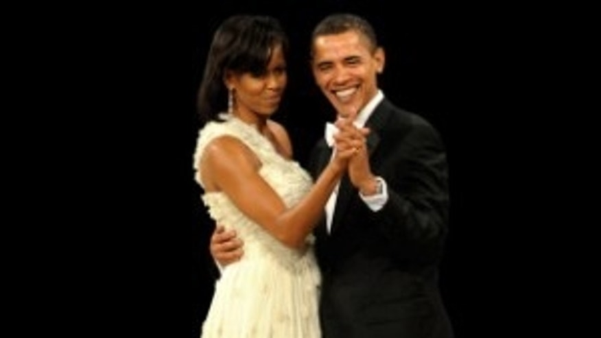 Michelle Obama dances with her husband at an inaugural ball. January 20, 2009/AP PHOTO