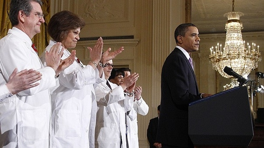 Mar. 3: Health professionals applaud as President Obama speaks about health care reform at the White House.