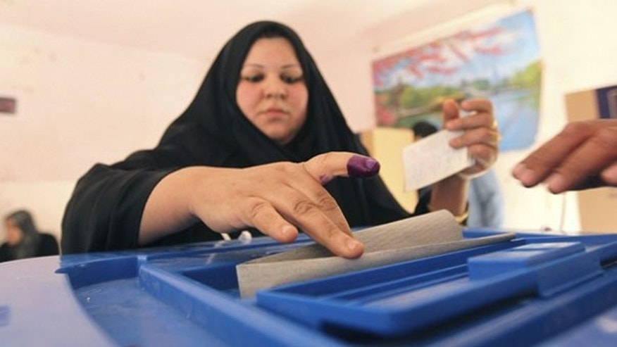 A resident casts her vote at a polling station in Baghdad's Sadr City March 7. (Reuters Photo)